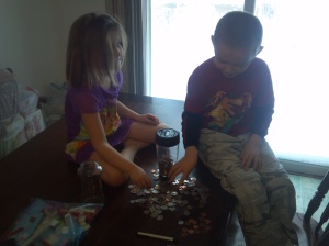 Counting money with the automatic bank Russell got for his birthday.