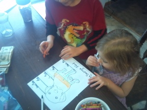 Hazel can't quite grasp the math concept, but she does get into coloring the chart!